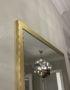 Настенное зеркало латунь
